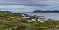 Small village community in Newfoundland.  Houses nestled amongst rocky landscape in Twillingate Newfoundland, Canada. Royalty Free Stock Photo