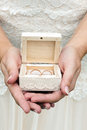 Small vintage coffer ivory case with wedding rings held in womens palms Royalty Free Stock Photos