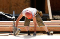 Small wall framing contractor worker working on a on a new commercial residential development Stock Images