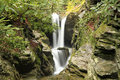 Small water fall in rocky gorge in springtime a creek a Stock Image