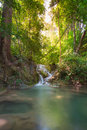 Small water fall in tropical deep forest jungle of thailand national park blue stream waterfall locate erawan nation kanjanaburi Royalty Free Stock Image