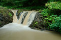 Small waterfall cascade with dirty water after the rain,Ukraine Royalty Free Stock Photo