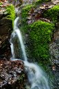 Small waterfall detail of on mossy rock Royalty Free Stock Photography