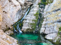 Small waterfall falling in lake Royalty Free Stock Photos