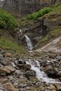 Small waterfall in the kloental valley spring scene swiss alps creek with waterfalls landscape Royalty Free Stock Image