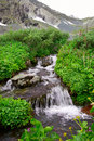 Small waterfall and mountain. Royalty Free Stock Images