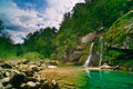 Small waterfall in mountain forest Royalty Free Stock Image