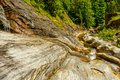 Small waterfall on a mountain river in romania Royalty Free Stock Image