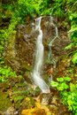 Small waterfall on a mountain river in romania Royalty Free Stock Photos