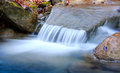 Small waterfall on mountain stream Royalty Free Stock Images