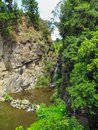 Small waterfall over rocks and tropical forest Royalty Free Stock Photo