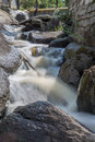 Small waterfall rapid stream running over rocks summer day su sunny Stock Images