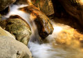 Small waterfall in river bed shot with long exposure Royalty Free Stock Photos