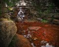 Small waterfall in stone grotto a cascades over mossy rocks a beautiful Royalty Free Stock Images