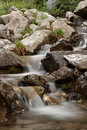 Small waterfall in stones Stock Images