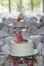 Small wedding cakes single flower as table centerpieces wedding reception Royalty Free Stock Photos