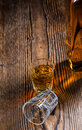 Small whiskey shot on an old wooden table Stock Photo