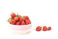 Small white bowl filled with red strawberries succulent juicy fresh ripe on Stock Images