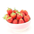 Small white bowl filled with red strawberries succulent juicy fresh ripe isolated on Stock Photos