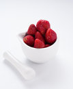 Small white china bowl filled with succulent juicy fresh ripe red strawberries Stock Photos