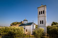 Small white church and bell tower in Ulcinj town, Montenegro Royalty Free Stock Photo