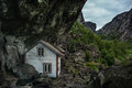 Small white, fishing house norway rock. Royalty Free Stock Photo