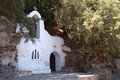 Small white Greek orthodox church Stock Photos
