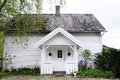 Small white house with front porch beautiful scandinavian a nice and a colorful garden norway Stock Photo