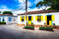 Small white houses with yellow window shutters in Buzios, Braz Royalty Free Stock Photo
