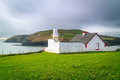 Small white lighthouse on the coast of ireland Stock Photography