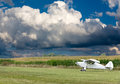 Small white microlight plane ready for take off Royalty Free Stock Photo