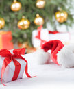 Small, white present and santa hat Stock Photo