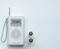 Small White Radio Receiver with two Batteries Royalty Free Stock Photo