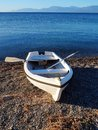 Small White Rowboat on Pebbly Bech Royalty Free Stock Photo