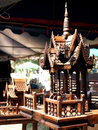 Small wood carved house spirit house in asian culture scaled from vintage traditional thai style temple with stepping roof showing Royalty Free Stock Photos