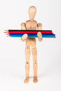 Small wood mannequin standing with bunch of colour pencil isolat isolated on white background Royalty Free Stock Images