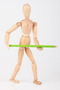 Small wood mannequin standing with colour pencil isolated on whi white background Stock Image