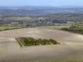 Small wood surrounded by chalky field in west berkshire near inkpen england taken from up on gallows hill Royalty Free Stock Photography