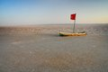 Small wooden boat at dried chott el jerid large endorheic salt lake in tunisia Royalty Free Stock Image