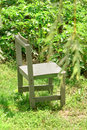 Small wooden chair in garden Royalty Free Stock Photo