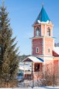 Small wooden church with a bell tower in tyulyuk russia Royalty Free Stock Photography