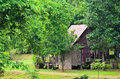 Small wooden cottage in the forest Royalty Free Stock Photo