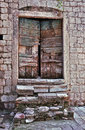 Small wooden door broken stone staircase very old mediterranean house Stock Photography