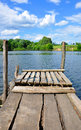 Small wooden pier near the river Royalty Free Stock Photo