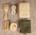 Small wooden spa set, sponge, pumice stone, a mirror, towel, brush, comb Royalty Free Stock Photo