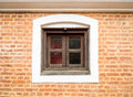 Small wooden window and brick wall a Stock Photography