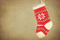 Small Xmas stocking hanging on rustic background Royalty Free Stock Photography
