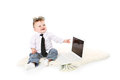 Small young businessman enjoys a laptop and money Stock Photo