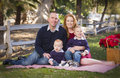 Small young family holiday portrait beautiful in the park Stock Photo
