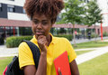Smart african american female student outdoor on campus Royalty Free Stock Photo
